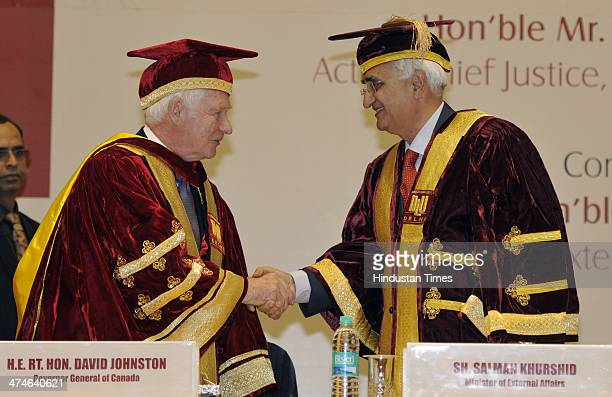 Governor General of Canada David Johnston with External Affairs Minister Salman Khurshid after being conferred LL.D at the Special Convocation of...