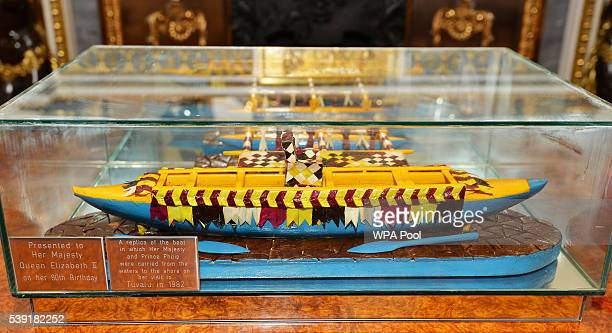 Governor General Sir Iakoba Italeli of Tuvalu presented Queen Elizabeth II with a replica canoe of the one she and the Duke of Edinburgh arrived by...