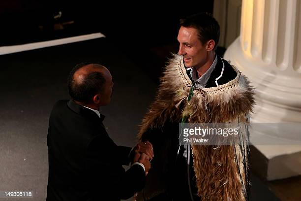 Governor General Sir Jerry Mateparae shakes hands with New Zealand flag bearer Nick Willis of New Zealand during the NZOC Governor General's Gala...