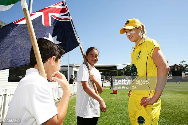 Governor General's XI captain Ellyse Perrytalks to the young flagbearers before the women's tour match between the Governer General's XI and South...