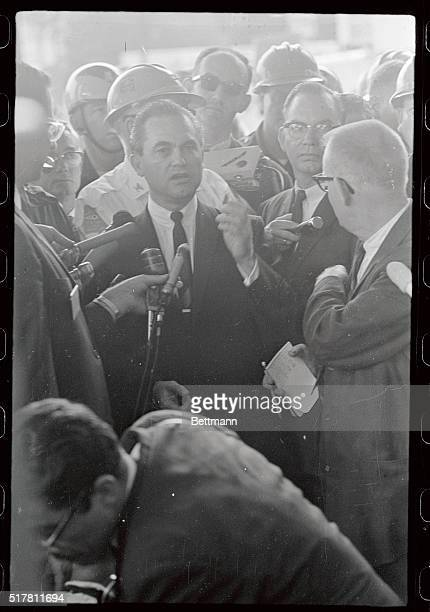 Defiant Governor George C Wallace holds impromptu news conference here after his arrival from Montgomery to carry out his promise to prevent...