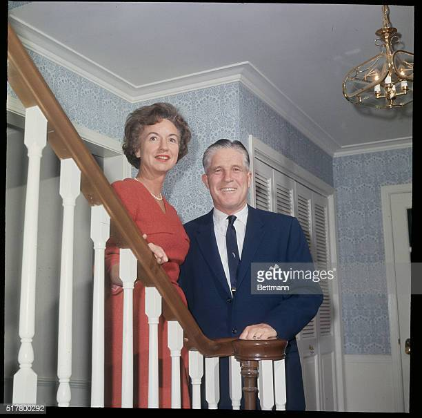 Governor George Romney and his wife are shown together as they pose for the camera
