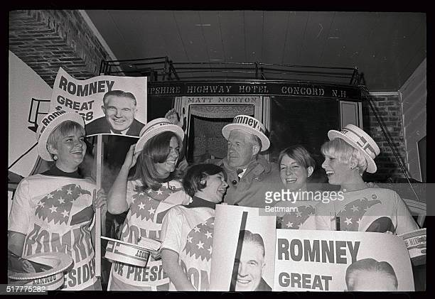 Governor George Romney of Michigan is surrounded by youthful campaign workers on his arrival here as he opens his sixday primary campaign of the...