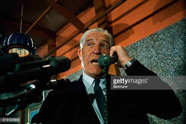 Governor George Romney of Michigan speaking into microphones and also a telephone He has announced his withdrawal as a GOP Presidential candidate