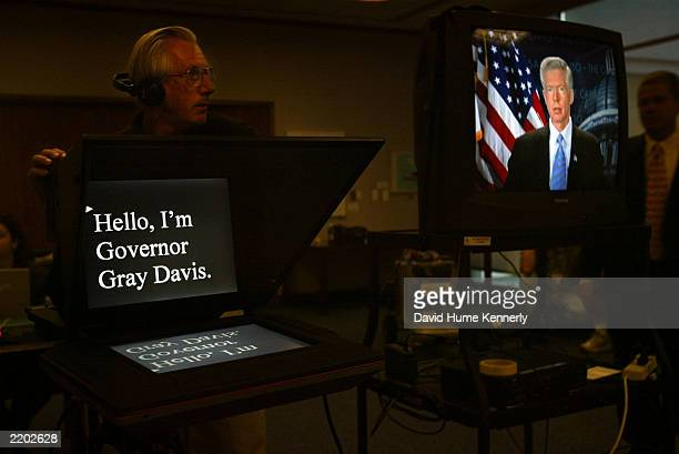 Governor Gray Davis appears on a monitor as he waits to tape a message from his office in the Capitol Building July 16 2003 in Sacramento CA The...