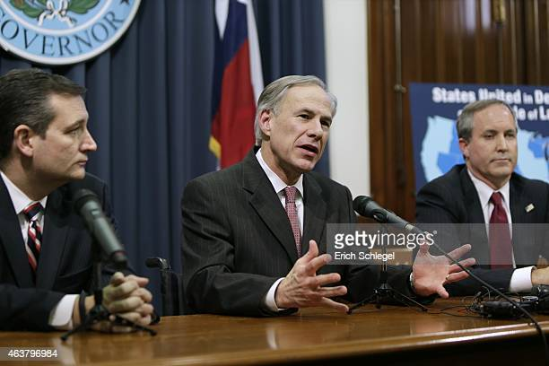 Governor Greg Abbott speaks alongside US Sen Ted Cruz Attorney General Ken Paxton at a joint press conference February 18 2015 in Austin Texas The...