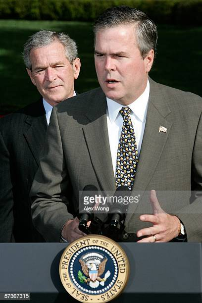 Governor Jeb Bush speaks to the press on the war on terror as his brother US President George W Bush looks on April 19 2006 at the White House in...