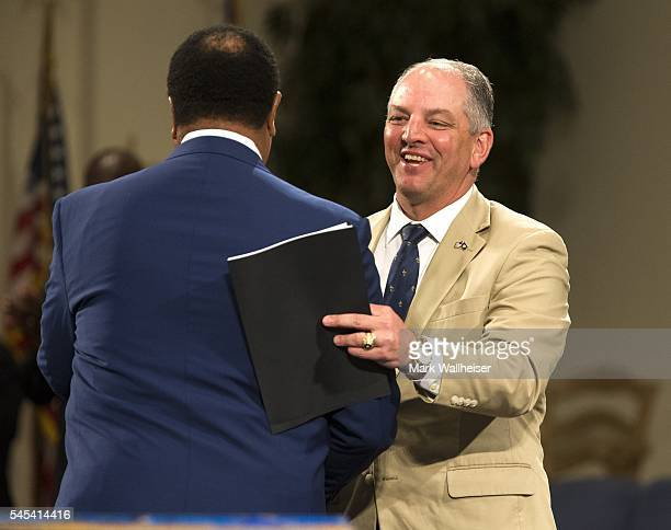 Governor John Bel Edwards of Louisiana is introduced during a prayer vigil for Alton Sterling at the Living Faith Christian Center July 7 2016 in...