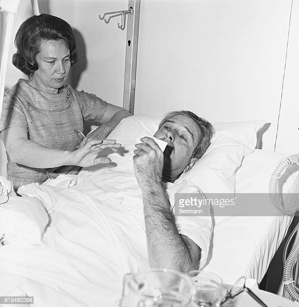 Governor John Connally wipes tears from his eyes while lying in a hospital bed after being shot during the assassination of John F Kennedy