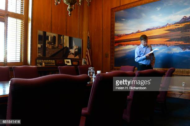 Governor John Hickenlooper has a quiet moment in his office in between daily meetings in the state capitol in Denver CO on September 10 2014