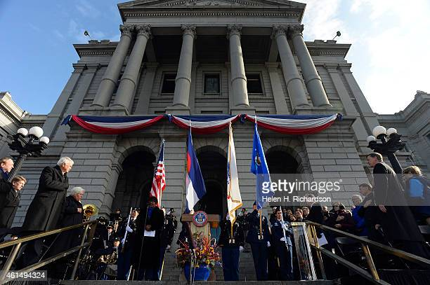 Governor John Hickenlooper right watches the presentation of the colors by the Colorado National Guard Honor Guard during the inauguration ceremony...