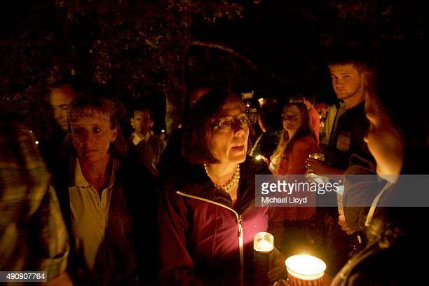 Governor Kate Brown of Oregon attends at a candlelight vigil for the victims of a shooting at Umpqua Community College October 1 2015 in Roseburg...