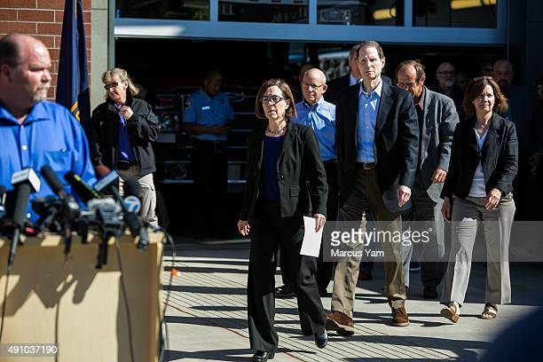 Governor Kate Brown walks out with local and state officials for a press conference outside the Roseburg Fire Department Administration building on...