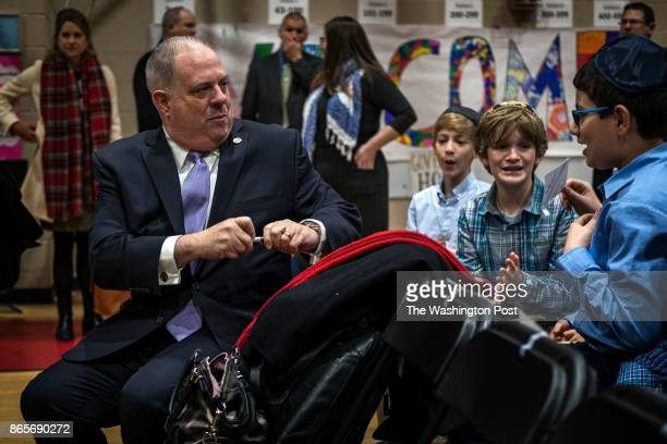 Governor Larry Hogan signs an autograph for a student before speaking to a school assembly during a visit to Charles E Smith Jewish Day School in...