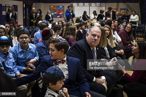 Governor Larry Hogan sits with students before speaking to a school assembly during a visit to Charles E Smith Jewish Day School in Rockville...
