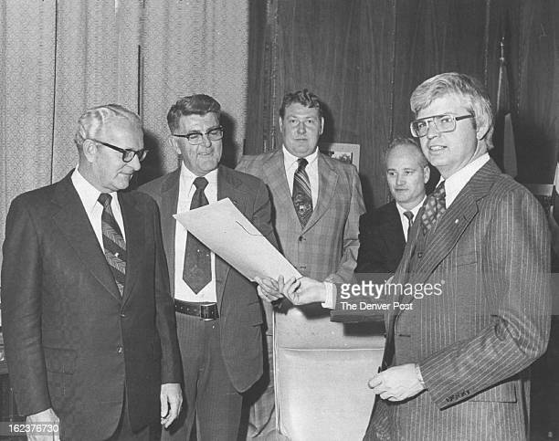 OCT 10 1975 OCT 13 1975 Governor Lends Support to Credit Unions Colorado Banking Commissioner Harry Bloom left and three credit union executives...