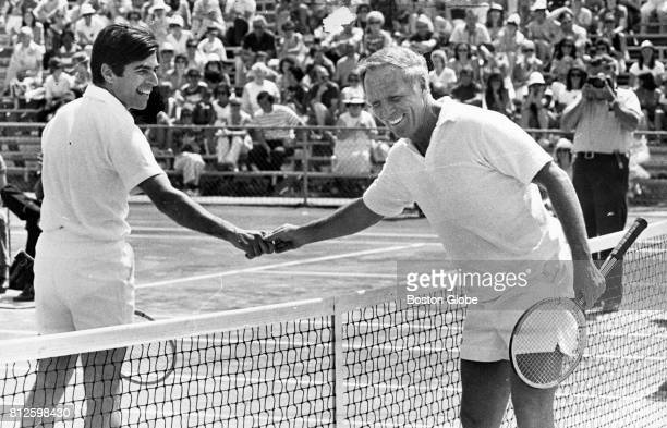 Governor Michael Dukakis and Boston Mayor Kevin White shake hands after a charity match at Longwood Tennis Club in Chestnut Hill on June 21 1975
