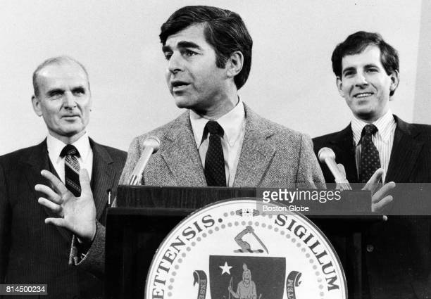 Governor Michael Dukakis speaks at a press conference at the State House in Boston on Jan 8 1983 Behind him are new Secretary of Public Safety...