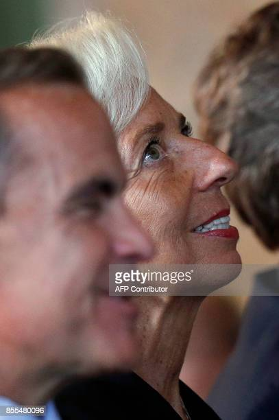 Governor of Bank of England, Mark Carney and Managing Director of the International Monetary Fund , Christine Lagarde , listen to a speaker on the...