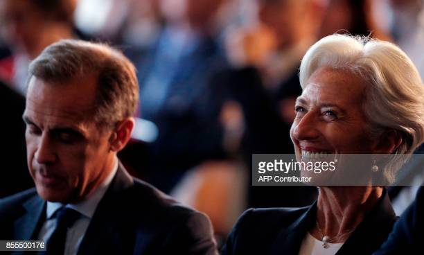 Governor of Bank of England, Mark Carney and Managing Director of the International Monetary Fund , Christine Lagarde listen to a speaker on the...