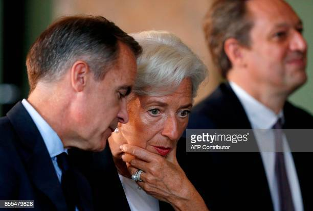 Governor of Bank of England, Mark Carney talks with Managing Director of the International Monetary Fund , Christine Lagarde on the second day of the...