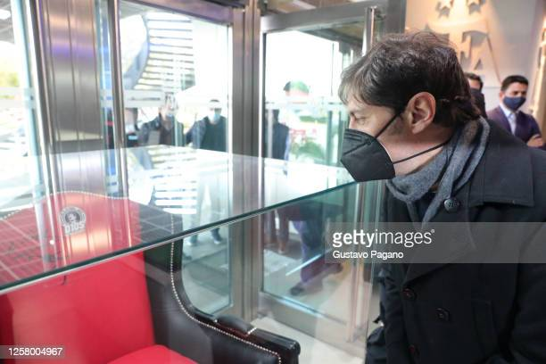 Governor of Buenos Aires Province Axel Kicillof looks at a chair used and signed by Diego Maradona pior a press conference to launch a campaign to...