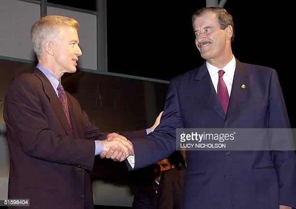 Governor of California Gray Davis shakes hands with Mexican President Vicente Fox after giving a welcoming speech at the inauguration of the 'Mexico...