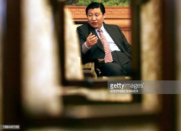 Governor of China's coastal Fujian province Xi Jinping responds to a journalist's question 23 February 2000 during an interview at the central...