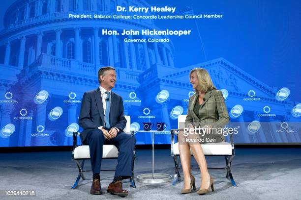 Governor of Colorado Hon John Hickenlooper and President of Babson College Dr Kerry Healey speak onstage during the 2018 Concordia Annual Summit Day...