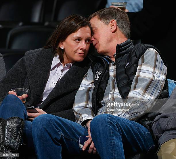 Governor of Colorado John Hickenlooper and his girlfriend Robin Pringle attend the Denver Nuggets game against the Milwaukee Bucks at Pepsi Center on...