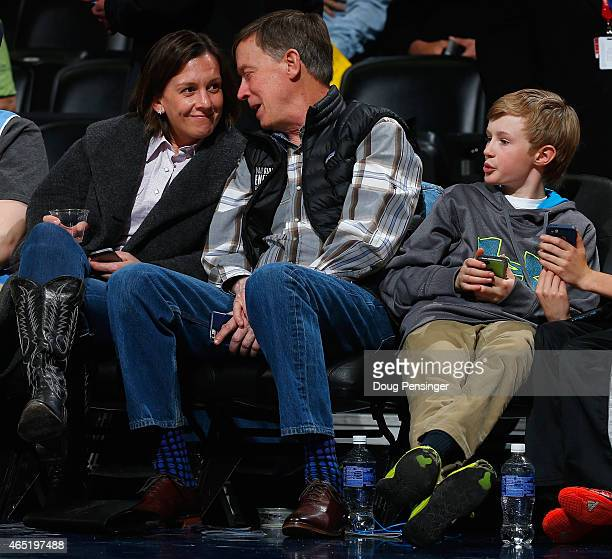Governor of Colorado John Hickenlooper attends the Denver Nuggets game against the Milwaukee Bucks along with girlfriend Robin Pringle and his son...