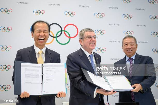Governor of Gangwon Province, Choi Moon-soon, International Olympic Committee President Thomas Bach and IOC Singaporean member Ng Ser Miang pose with...