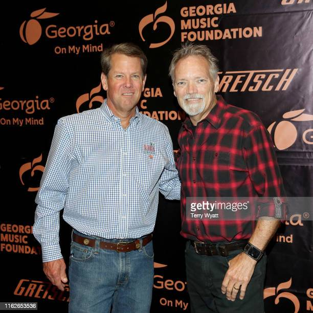 Governor of Georgia Brian Kemp and artist John Berry take photos backstage during the 6th Annual Georgia On My Mind presented by Gretsch at Ryman...