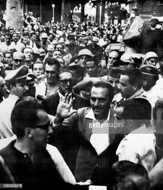 Governor of Guanabara state Carlos Lacerda walks with political supporters who celebrate the military putsch that led to the overthrow of President...