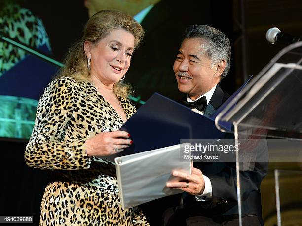 Governor of Hawaii David Ige presents honoree Catherine Deneuve with a proclamation at the 6th Annual Hawaii European Cinema Film Festival Awards...