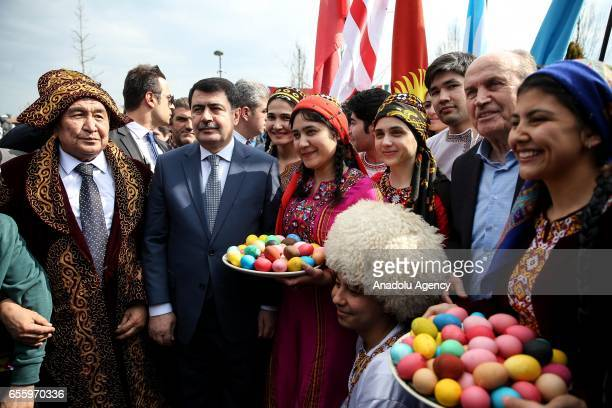 Governor of Istanbul Vasip Sahin and Mayor of Istanbul Kadir Topbas pose for a photo with participants during the Newroz celebrations at Topkapi...