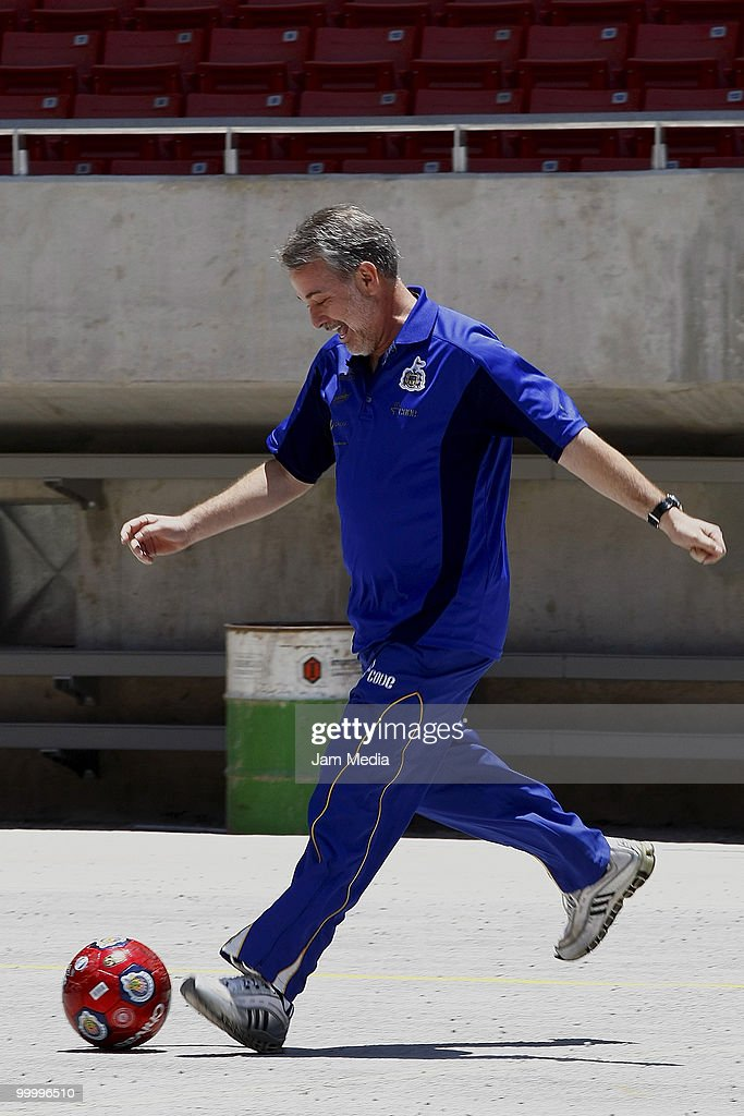Governor of Jalisco Emilio Gonzalez (C) plays with a ball during a visit to the construction of new Chivas Guadalajara stadium on May 19, 2010 in Guadalajara, Mexico.