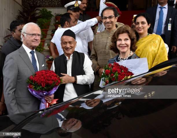 Governor of Maharashtra Bhagat Singh Koshyari along with Maharashtra Chief Minister Uddhav Thackeray and wife Rashmi welcome the Swedish King Carl...