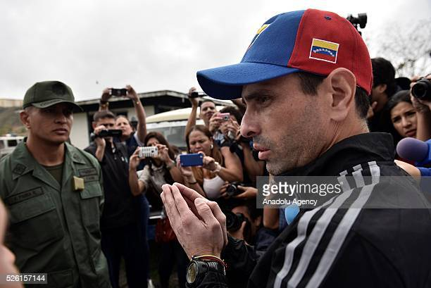 Governor of Miranda state Henrique Capriles talks with a military officer asking permision to visit jailed opposition Leader Leopoldo Lopez on his...