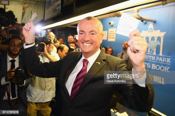 Governor of New Jersey Phil Murphy places the first bet at the William Hill Sports Book at Monmouth Park as it opens and welcomes public to place...