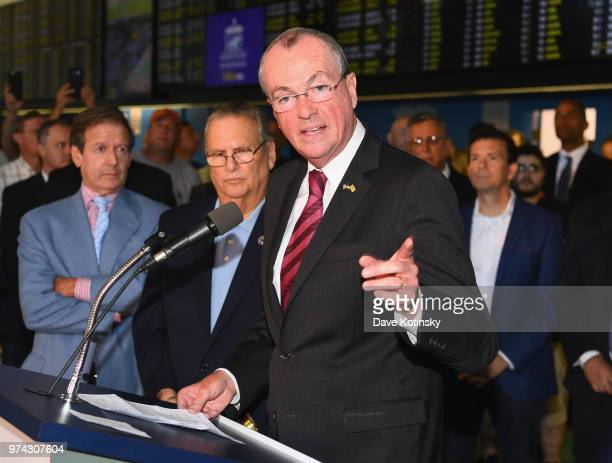 Governor of New Jersey Phil Murphy speaks during the William Hill Sports Book at Monmouth Park as it opens and welcomes public to place first legal...