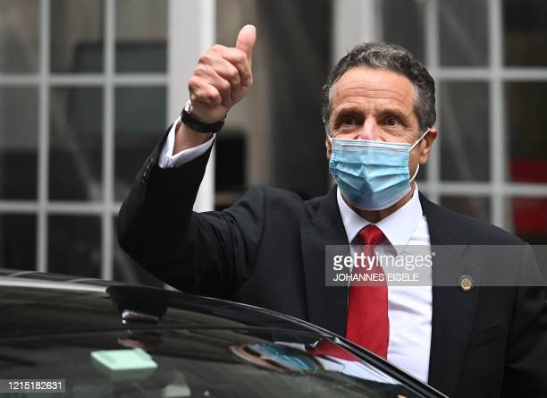Governor of New York Andrew Cuomo leaves after ringing the opening bell at the New York Stock Exchange on May 26, 2020 at Wall Street in New York...