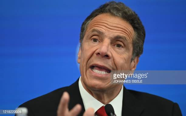Governor of New York Andrew Cuomo speaks during a press conference at the New York Stock Exchange on May 26, 2020 at Wall Street in New York City. -...