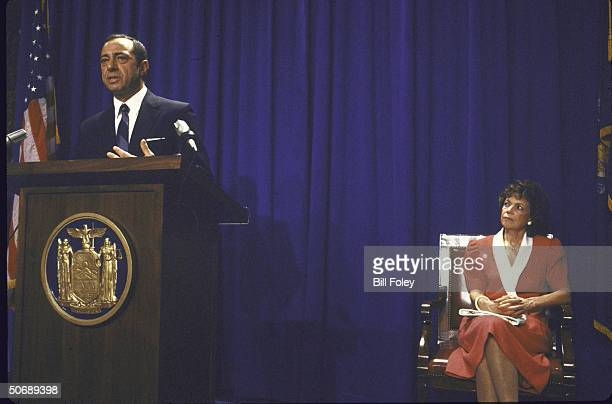 Governor of New York Mario M Cuomo at podium with state seal annouces he will seek reelection with wife Matilda seated at right