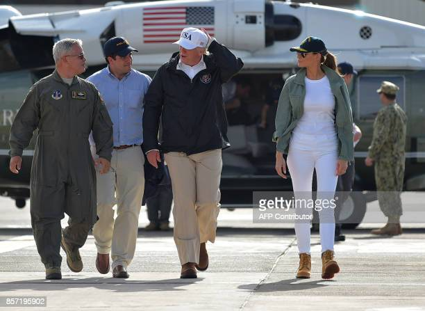 Governor of Puerto Rico Ricardo Rossello US President Donald Trump and First Lady Melania Trump walk to Air Force One before departing from Luis...