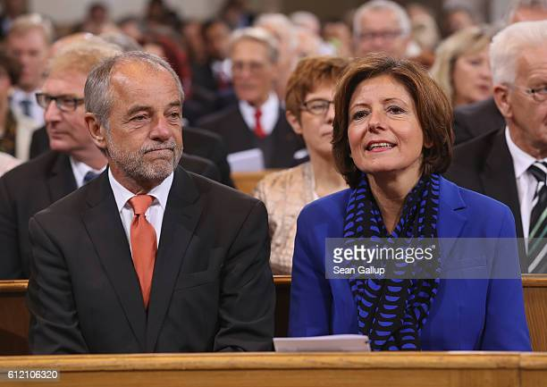 Governor of Rhineland-Palatinate Malu Dreyer and her husband Klaus Jensen arrive for a commemoratory service at the Frauenkirche church during...