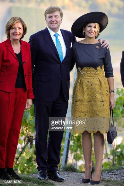Governor of RhinelandPalatinate Malu Dreyer King Willem Alexander of The Netherlands and Queen Maxima of The Netherlands inspecting local vineyards...
