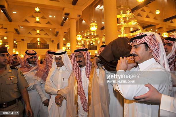 Governor of Riyadh Prince Salman bin Abdel Aziz and members of the royal family carry the body of the late Saudi Crown Prince Sultan bin Abdel Aziz...