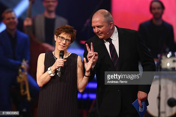 Governor of Saarland Annegret KrampKarrenbauer speaks as moderator Joerg Thadeusz looks on during the 52th Grimme Award on April 8 2016 in Marl...