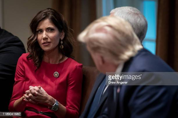 Governor of South Dakota Kristi Noem speaks as U.S. President Donald Trump listens during a meeting about the Governors Initiative on Regulatory...